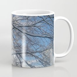 Snow-decorated trees Coffee Mug