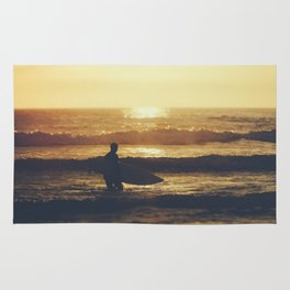 Sunset Surfer at Fistral Beach, Newquay, Cornwall Rug