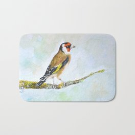 European goldfinch on tree branch Bath Mat