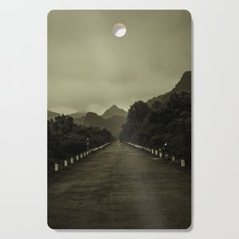 Road into the Mountains in Sepia. Vintage Travel Photography. Cutting Board