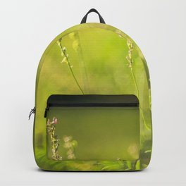Wild flowers in the green meadow Backpack