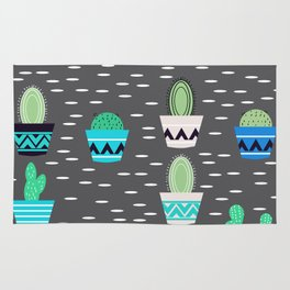 Potted cacti on a gray background Rug
