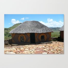 Thatch roof house Canvas Print