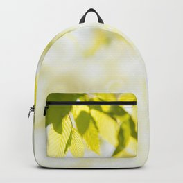 Elm green leaves and blurred space Backpack