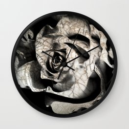 Rose forming from light and shadows Wall Clock