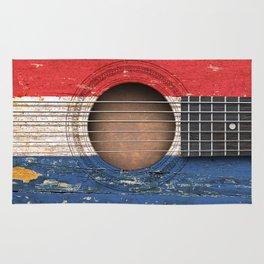 Old Vintage Acoustic Guitar with Dutch Flag Rug