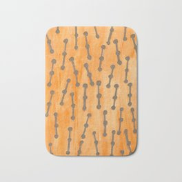 Golden Connected Points on Orange Pattern Bath Mat