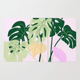 monstera plant on pink background Rug