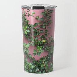 Blooming red hibiscus flowers against a mauve wall Travel Mug