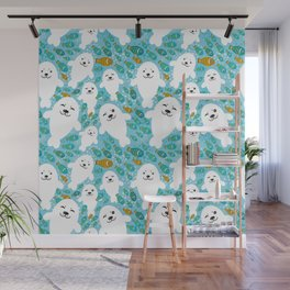White cute fur seal and fish in water Wall Mural