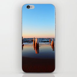 Reflected Remains on the Beach iPhone Skin