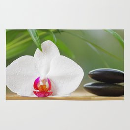 Relax with orchid flower and hot stones Rug