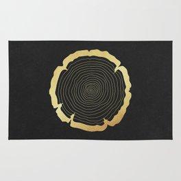 Metallic Gold Tree Ring on Black Rug