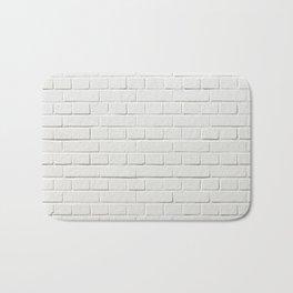 white brick wall tapestry Bath Mat