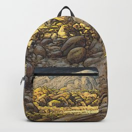 Rocky desert at sunset Backpack