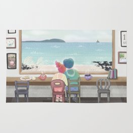 cafe with a view of the ocean Rug