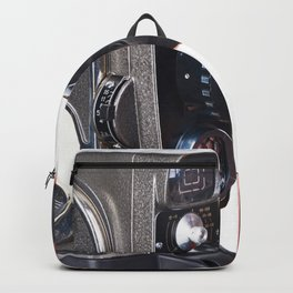 Retro mechanical hobbies movie camera and film in hands Backpack