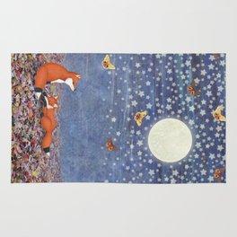 moonlit foxes Rug