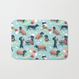 Hot dogs and lemonade // aqua background navy dachshunds Bath Mat