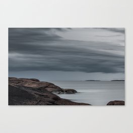 Cliffs with smooth water Canvas Print