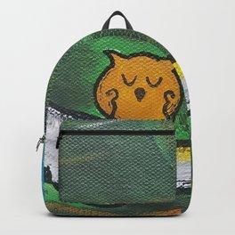 Owl Sleeps In Backpack
