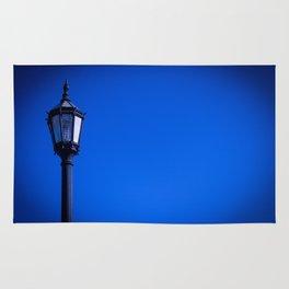 lamp over blue sky Rug