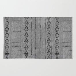 Dark Tribal Block Print 2 in dark gray and black with diamond and dashed line pattern Rug