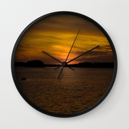 The sun goes down and night falls Wall Clock