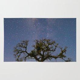Milky Way over a Ceiba tree Rug