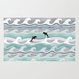 dolphins and waves Rug