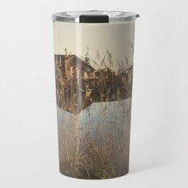 A cottage along a river Travel Mug