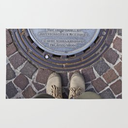 Man standing in front of a manhole Rug