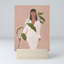 Elegant Lady holding a Flower Mini Art Print