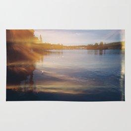 Leaking sunshine across the lake Rug