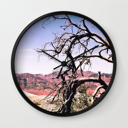 tree in the desert with mountain and blue sky in summer at Death Valley national park, USA Wall Clock