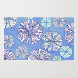 sea urchin blue watercolor Rug