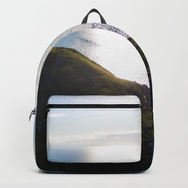 cable bay at sunset new zealand Backpack