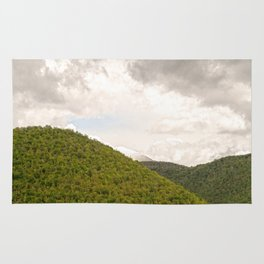 Dramatic summer mountain cloudscape Rug