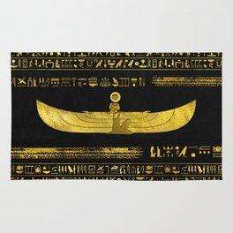 Golden Egyptian God Ornament on black leather Rug