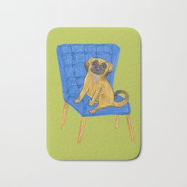 Happy Pug on a blue chair Bath Mat