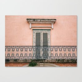 Old doors and balcony on a coral pink background in Italy Canvas Print