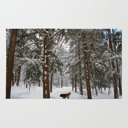 Dog exploring a snowy forest Rug