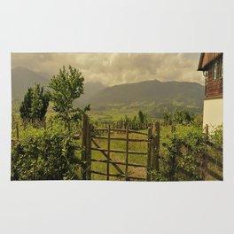farmerhouse in the mountains Rug