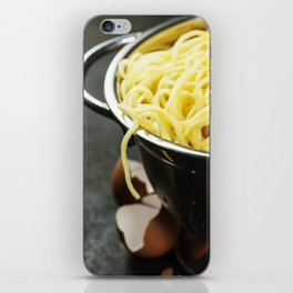 spaghetti in colander on dark vintage background iPhone Skin