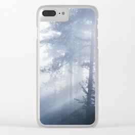 Sun rays shinning through foggy forest Clear iPhone Case