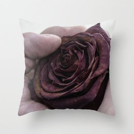 Hand Clutching a Dying Rose Throw Pillow