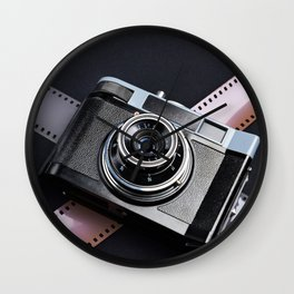 Vintage camera and films on black Wall Clock