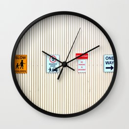 Signs on a corrugated metal wall Wall Clock