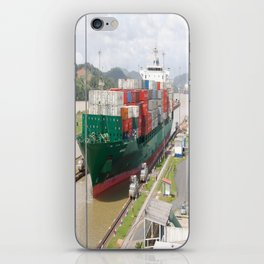 A cargo ship crossing the Miraflores locks at the Panama Canal iPhone Skin