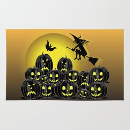 Pumpkins and witch in front of a full moon Rug